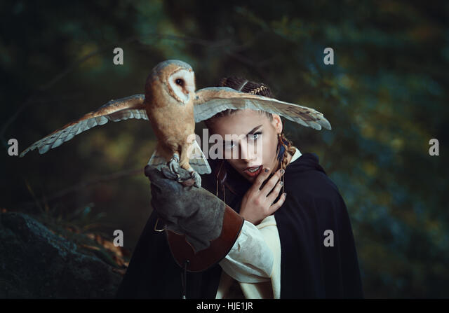 Mysterious woman with open winged barn owl. Fantasy portrait - Stock-Bilder