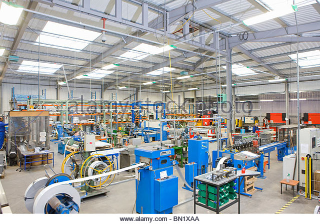 View of machinery in factory which manufactures aluminium light fittings - Stock Image