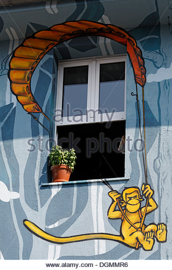 Monkey hanging from a parachute, window in artistically painted house, street art style, Kiefernstrasse, Duesseldorf - Stock-Bilder