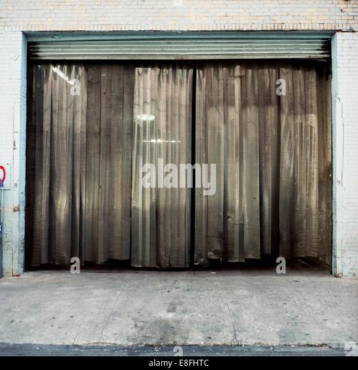 USA, New York State, New York City, Curtain in garage door - Stock Image