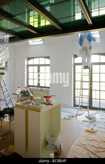 house painter renovating - Stock Image