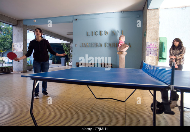 Young students playing table tennis in the occupied Liceo Nº1 'Javiera Carrera'  high school for girls - Stock Image