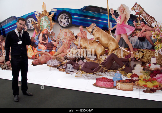 Frieze Art Fair London October 2008. Art dealer on his mobile phone next to Decadence by David Lachapelle - Stock Image
