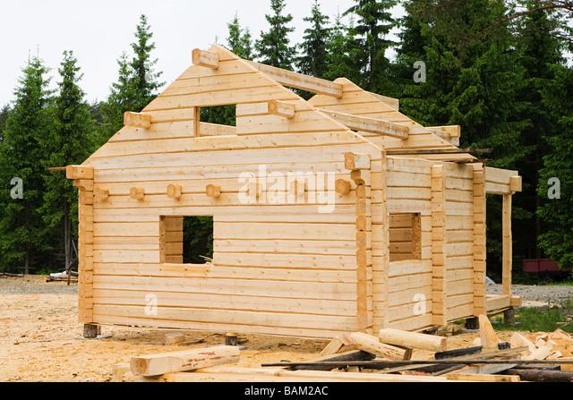 Wooden cabin under construction - Stock-Bilder