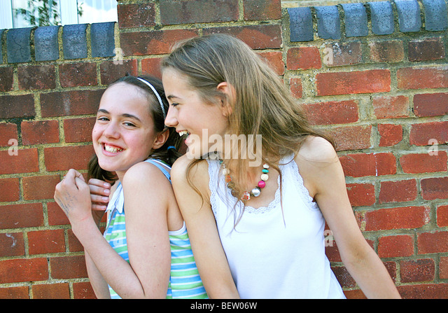 two girls larking around and having fun - Stock Image