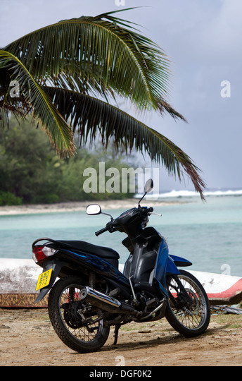 Motorbike on the beach on Sep 16 2013.It's one of the must popular activity in the Island but Cook Islands Driver's - Stock Image