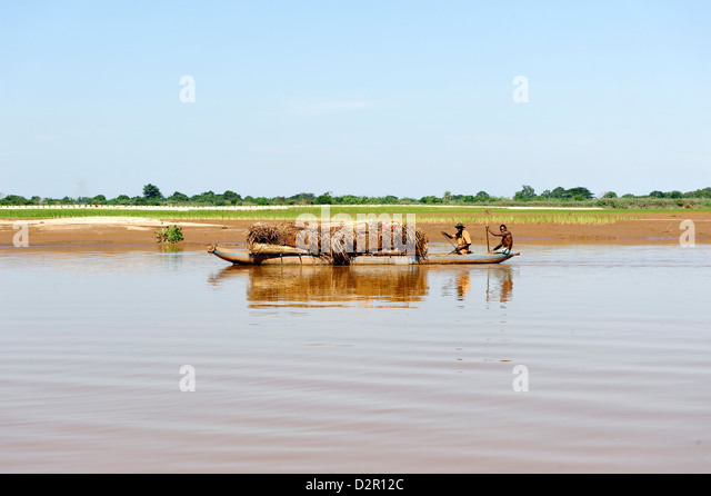 Along Tsiribihina, a river flowing from Madagascar in the Mozambique Channel by a delta, Madagascar, Indian Ocean, - Stock Image