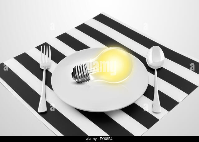 Lamp in plate and fork and spoon, Serving an idea concept - Stock Image
