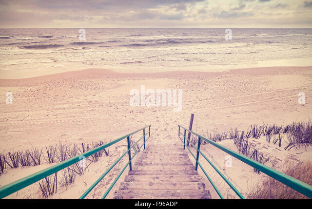 Vintage toned wooden stairs on a beach. - Stock-Bilder