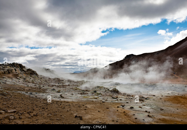 Iceland, Namafjall, fumaroles and mudpots releasing steam and sulfur gas - Stock Image