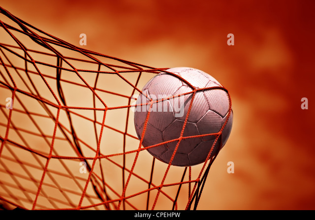 symbolic picture for goal with a soccer ball in net - Stock-Bilder
