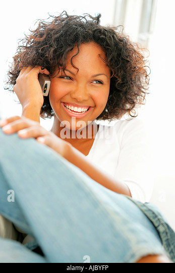 Mixed Race Woman on a Mobile Phone - Stock Image