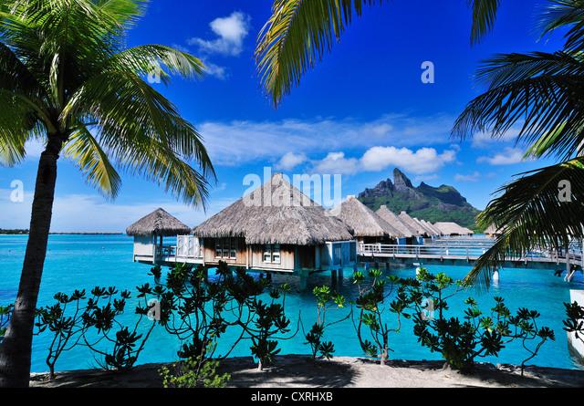 St. Regis Bora Bora Resort, Bora Bora, Leeward Islands, Society Islands, French Polynesia, Pacific Ocean - Stock Image