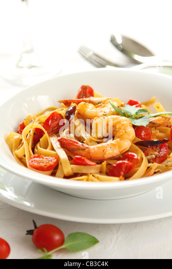 Pasta with tomato and prawn - Stock Image