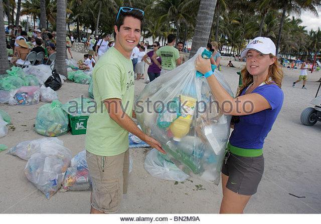 Miami Beach Florida Atlantic Ocean public beach shoreline ECOMB Big Sweep environment volunteer cleanup clean-up - Stock Image