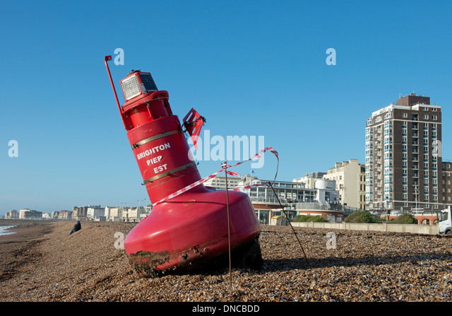 Beached Buoy On Hove Seafront, East Sussex, England. Uk - Stock Image