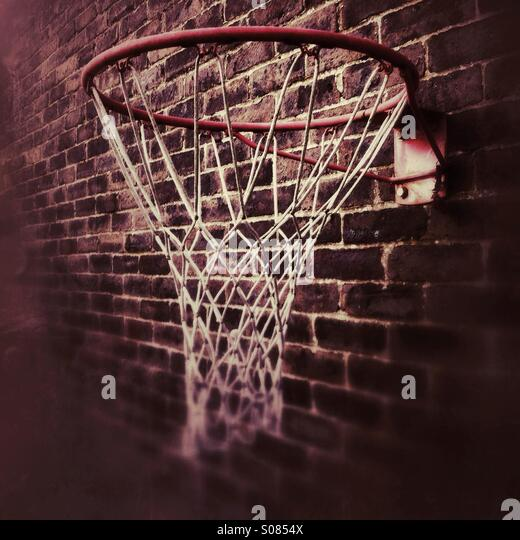 Netball net or hoop mounted on a brick wall - Stock Image