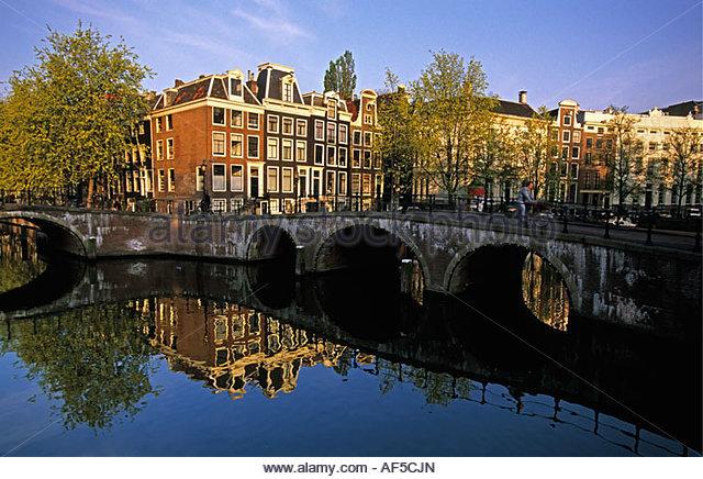 Netherlands Amsterdam Bridge and buildings at canal called Singel - Stock-Bilder
