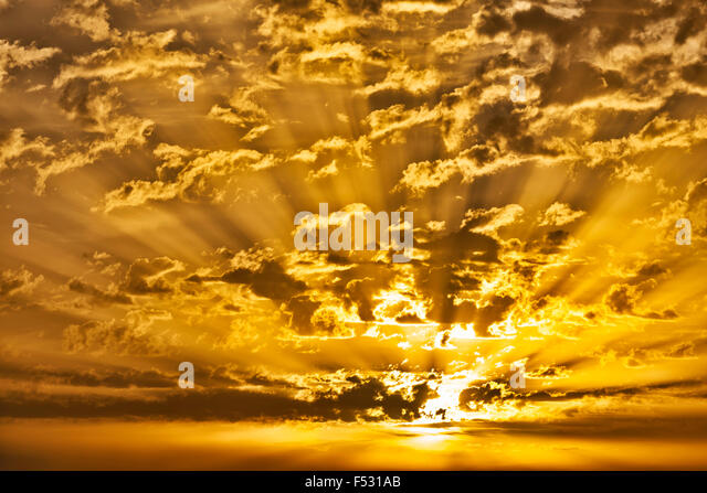 Sunrise with clouds and sunrays. - Stock Image