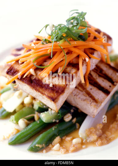 Pan fried tofu with peanut sauce at Mandala Spa, Boracay, Philippines. - Stock Image