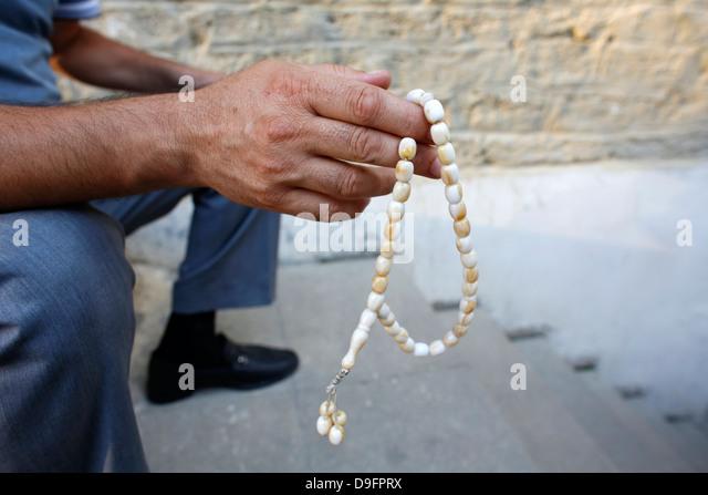 Man holding prayer beads, Baku, Azerbaijan, Central Asia - Stock Image