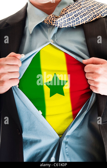 Business man showing Senegal flag shirt - Stock Image