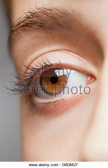 Eye lash close up detail brown macro face teenager - Stock Image