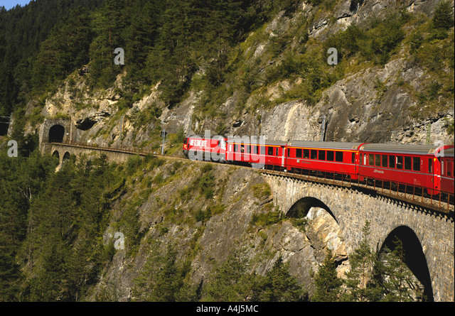 Switzerland train crossing bridge - Stock Image