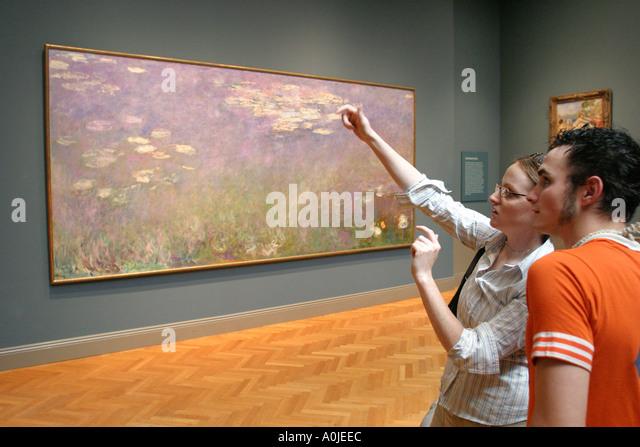 Cleveland Ohio University Circle Museum of Art impressionistic painting visitors - Stock Image