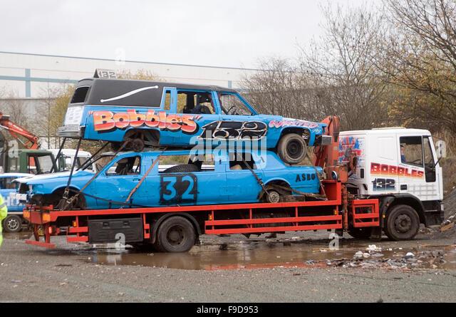 demolition destruction derby derbies cars arriving at track banger racing old cars on scrap lorry wagon lorries - Stock Image