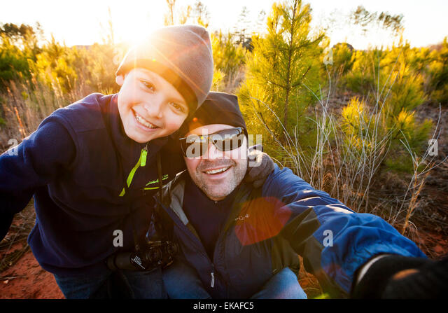father and son taking a selfie - Stock Image
