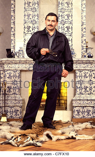 Mikhail Khodorkovsky standing on a tiger skin rug in Moscow, Russia in 1994 when he was President of Bank Menatep. - Stock Image