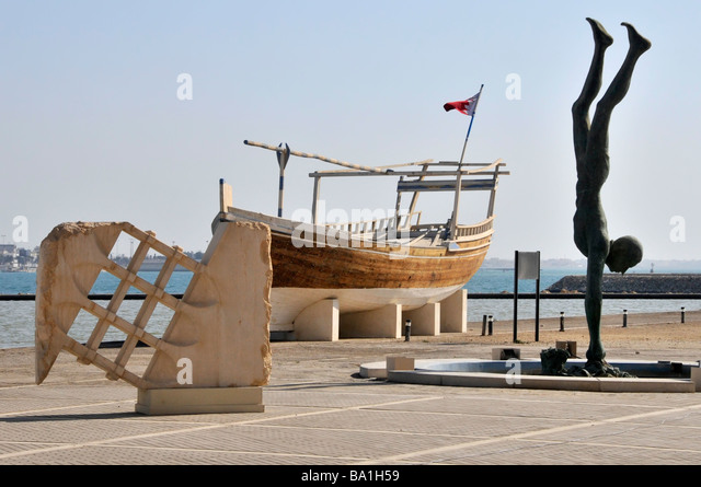 Bahrain National Museum outdoor exhibits including a dhow and sculptures - Stock Image