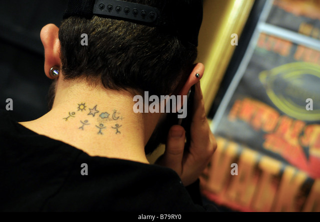 A unique tattoo on the neck of a young Turkish man in Tunel, Istanbul, Turkey. - Stock-Bilder