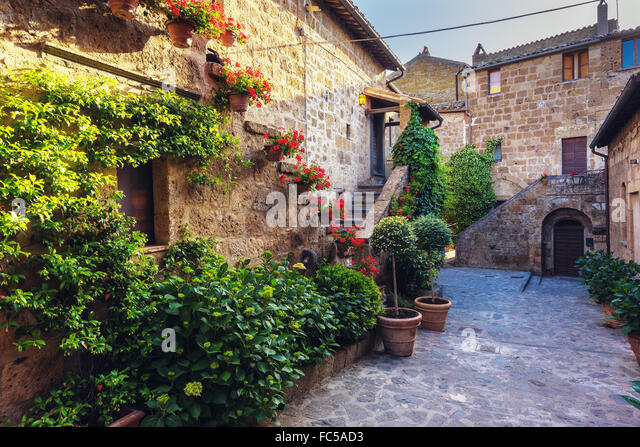Stairs with colorful flowers in a Tuscan old town - Stock-Bilder