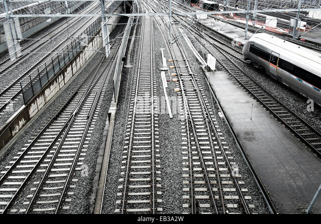 Norway, Oslo, Elevated view of railway tracks with passing high-speed train - Stock Image