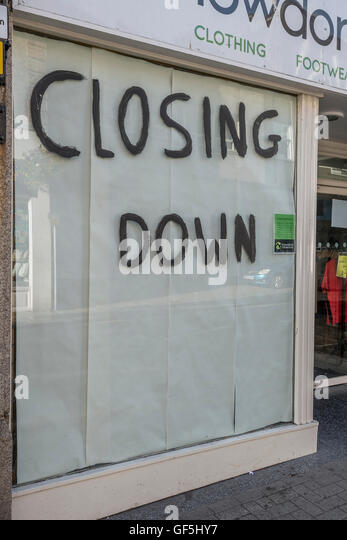 'Closing Down'  shop - as metaphor for concept of recession, economic slow-down, falling sales, and competition. - Stock Image