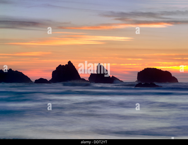 Sunset and rocks. Bandon, Oregon - Stock Image