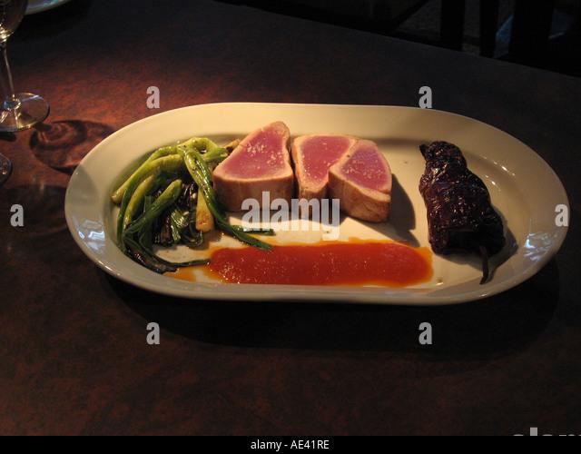 Fine dining at Philadelphia Fish Co restaurant Tuna entree Philadelphia Pennsylvania PA USA - Stock Image
