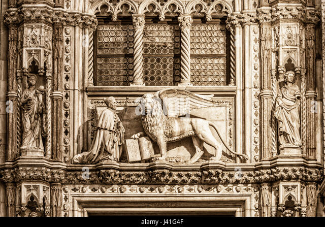 Lion of St. Marc , Doge palace, Porta della Carta - Stock Image