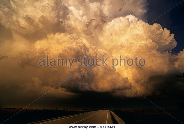 Ominous Tornado producing Supercell thunderstorm looms over US Highway 270 looking east toward small town of Laverne - Stock Image