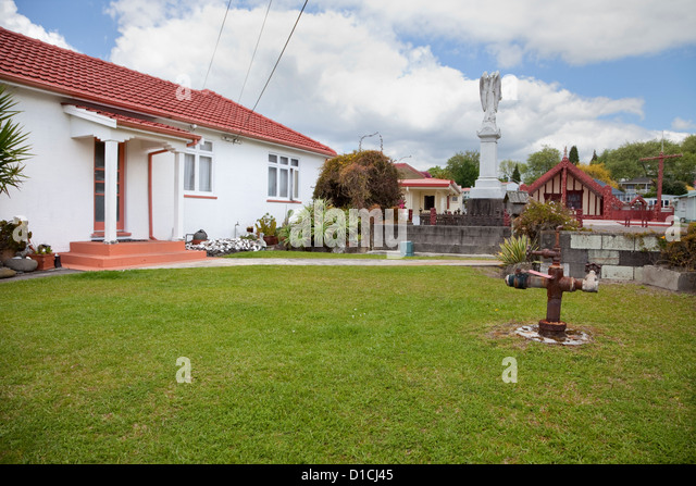 This 'thermal bore' in the yard of a resident's house identifies one of forty houses heated with geothermal - Stock Image