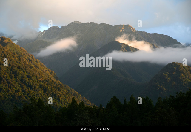 Sunset over the Southern Alps, Franz Josef, South Island, New Zealand - Stock Image
