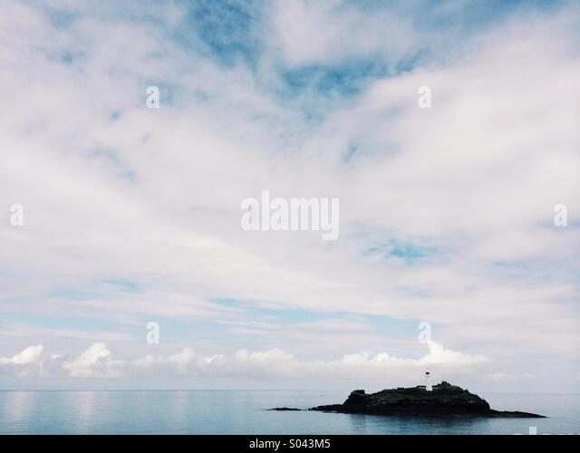 Godrevy lighthouse in Cornwall on a still and calm summers day. - Stock Image