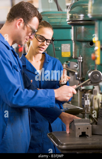 Two machinists working on machine - Stock Image