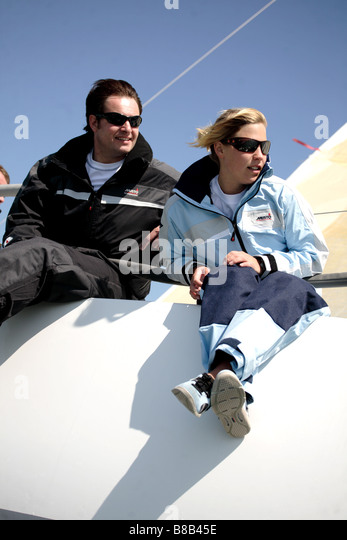 Man and woman sailing a yacht,the image is a color portrait action shot. - Stock Image