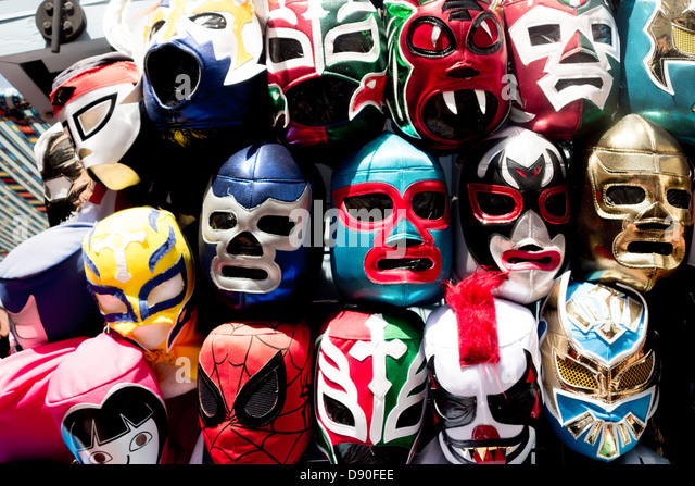 Masks of Mexican wrestling heroes at souvenir stall on Olvera Street in Los Angeles pueblo historic district in - Stock Image