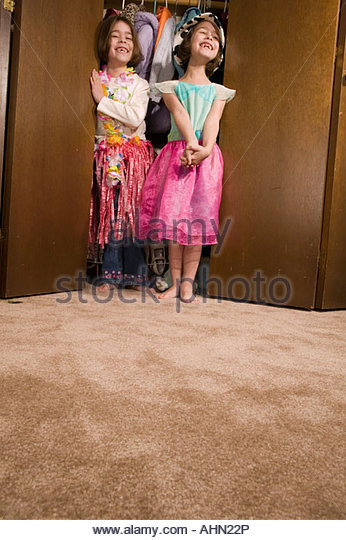 Young girls playing dress-up - Stock Image