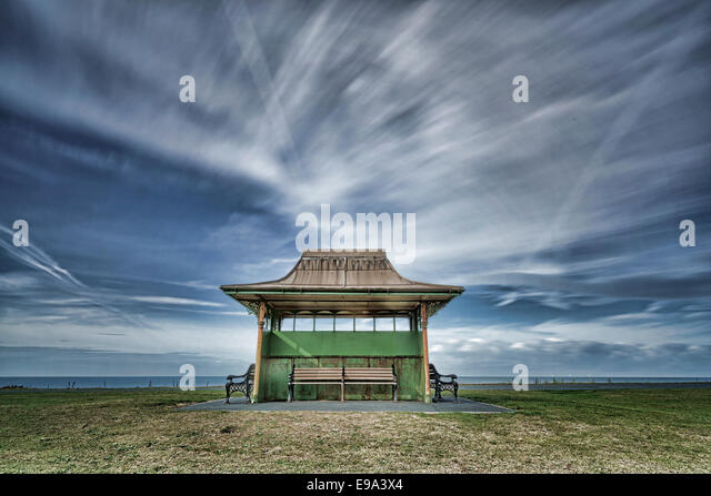 A small shelter set against an artistically blurred sky on Blackpool seafront (fine art) - Stock-Bilder