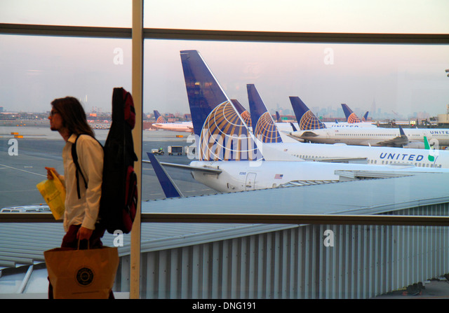 New Jersey Newark Newark Liberty International Airport EWR terminal concourse gate area tarmac window United Airlines - Stock Image